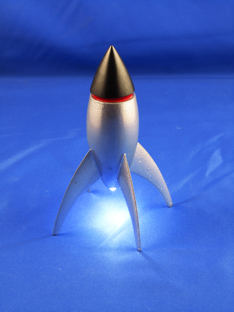 This little rocket will light the way through the darkness from a bedside table, no cords attached.