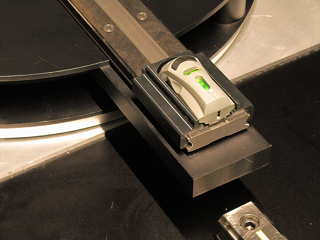 A laser line tool attachment alingns the fixture rail with the meter rail to assure squareness of the setup