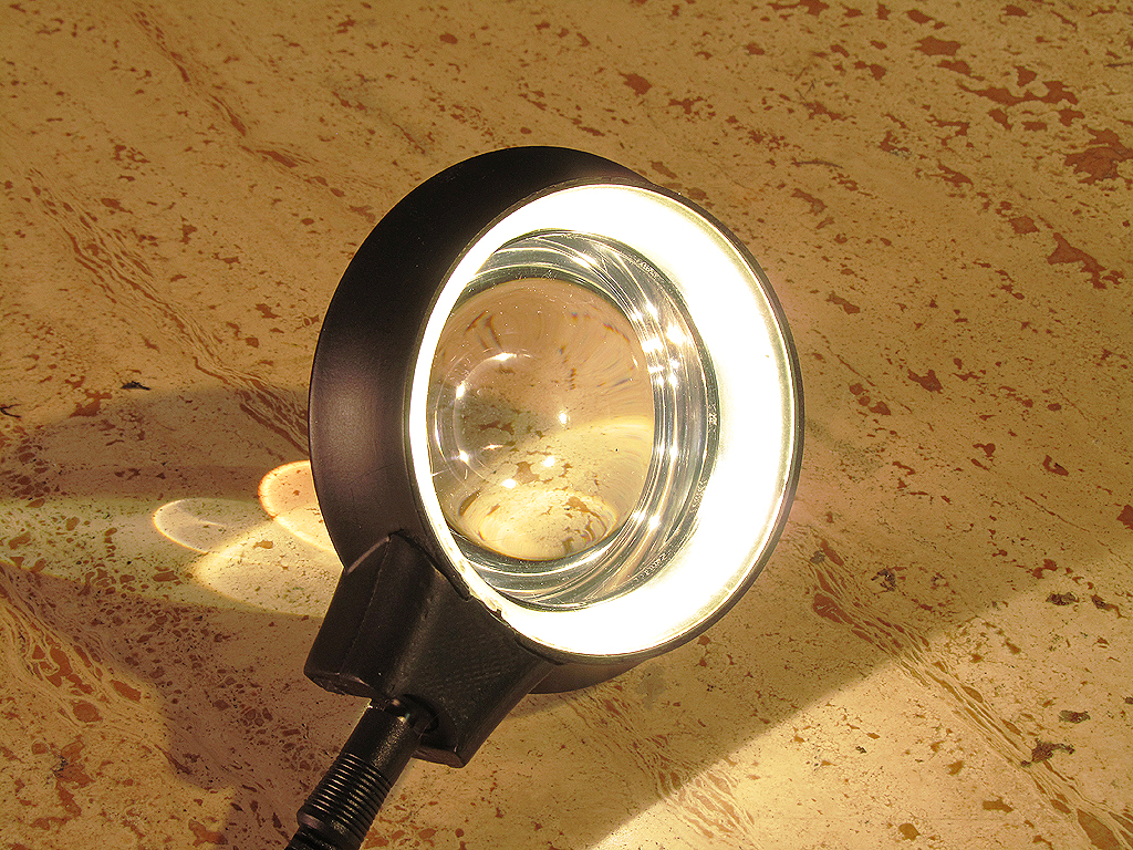 The LED light ring behind printed acrylic diffuser couples with the light gathering lens very well.