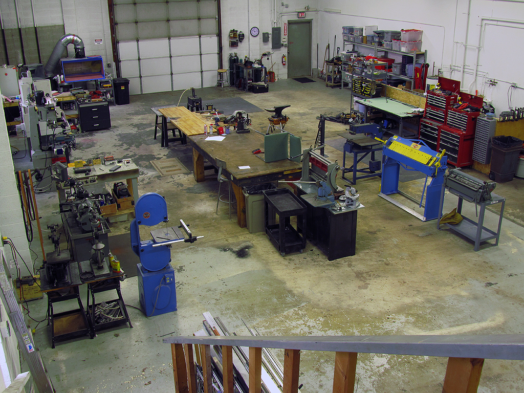 This view of the shop space shows the main space with sheet-metal fab in the center/right.